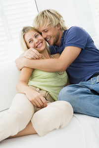 Couple in living room hugging and smiling