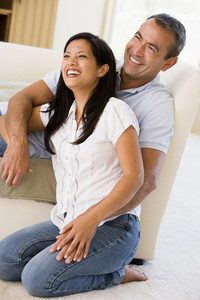 Couple in living room laughing