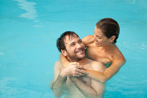 Couple in love inside the pool relaxed
