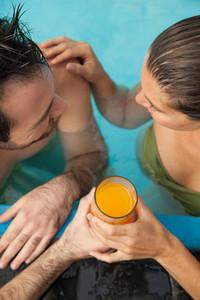 Couple in the pool having fun