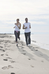 Couple Jogging On The Beach