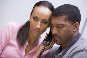 Couple listening to news over the telephone at home