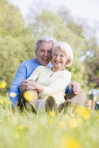 Couple relaxing outdoors smiling
