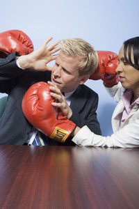 Coworkers punching each other in office