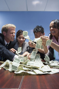 Coworkers with money in office