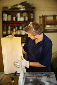 Craft worker working in industrial workshop