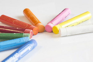 Crayons concept on white isolated background