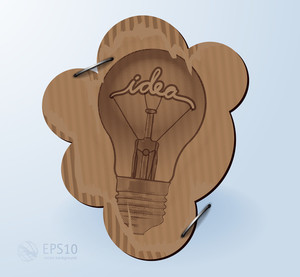 Creative Idea In Bulb Shape Drawn On Recycled Cardboard. Vector