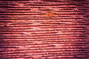 Crimped stone texture background in marsala color