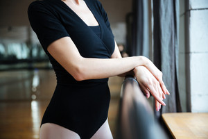 Cropped image of a ballerina standing in ballet class