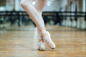Cropped image of a female legs in pointe shoos