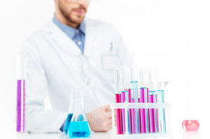 Cropped image of a scientist pouring chemicals in a laboratory