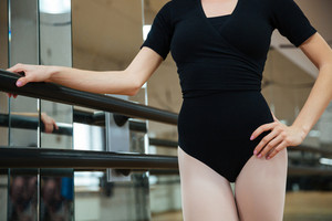 Cropped image of ballerina standing in ballet class