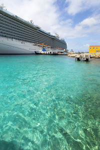 Cruise ship loading in clear, tropical waters