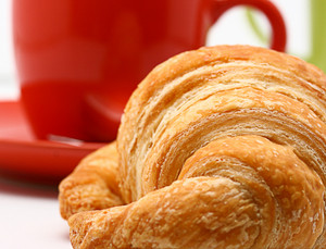 Cup Of Coffee And Croissant In The Morning