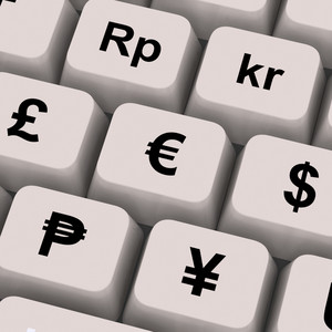 Currency Symbols On Computer Keys Showing Exchange Rates