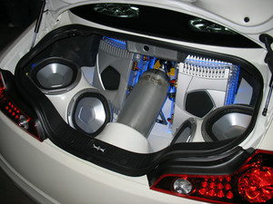 Custom audio system in the trunk of a sports car.
