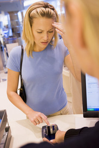 Customer in store struggling to remember PIN number