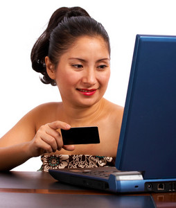 Customer Using A Credit Card To Buy On Her Computer