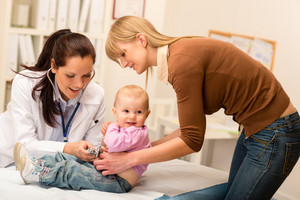 Cute baby being examine by pediatrician with stethoscope mother assistance