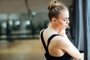 Cute ballerina standing in ballet class