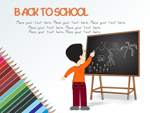 Cute Boy Standing In Front Of Blackboard