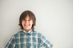 Cute boy with long hair posing