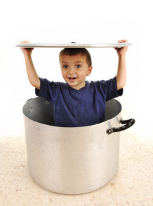 Cute child in pot, playing together, brothers