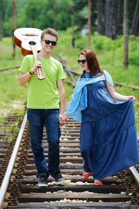 Cute couple on the railroad