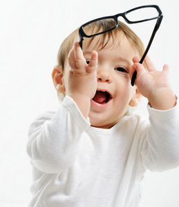 Cute funny baby with glasses