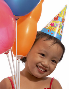 Cute Girl With A Birthday Hat And Balloons