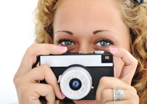 Cute girl with camera isolated