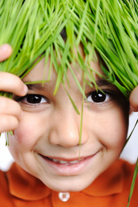 Cute happy kid with grass hair