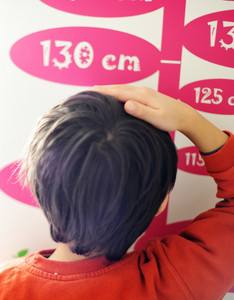 Cute kid measuring his height
