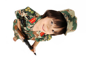 Cute kid with gun - topview