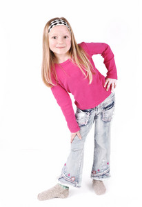 Cute little girl standing in studio