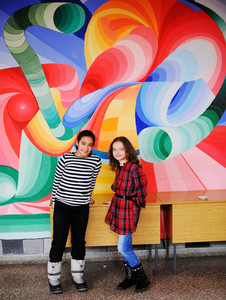Cute lovely school children making handmade art on wall