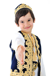 Cute middle-eastern child extending hand to shake