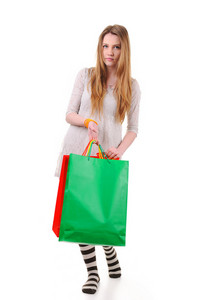 Cute teenage girl with shopping bags