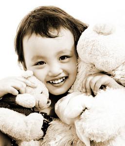 Cute Young Girl Hugging Two Teddy Bears