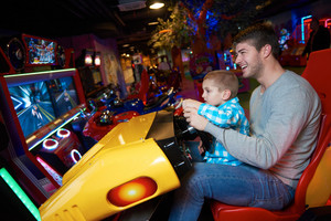 Dad and son playing racing game