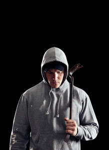 Dangerous guy with a crowbar in the dark