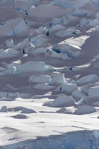 Close up of dense, sunlit snow