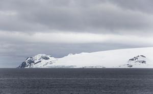 Snowy coast under a grey sky