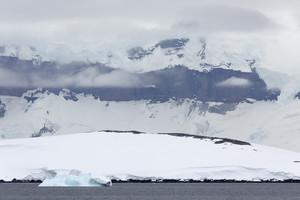 Ice floe and a snowy, foggy coast