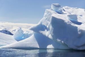 Close up of a sunlit iceberg along the coast
