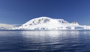 Snowy coast under a blue sky
