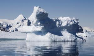 Sunlit iceberg under a blue sky