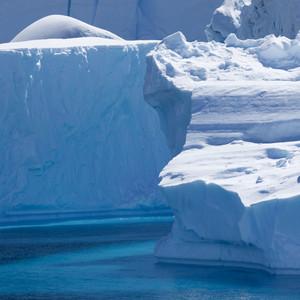 Close up of sunlit icebergs along the coast