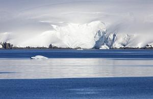 Sunlit, snowy coast and ice floe